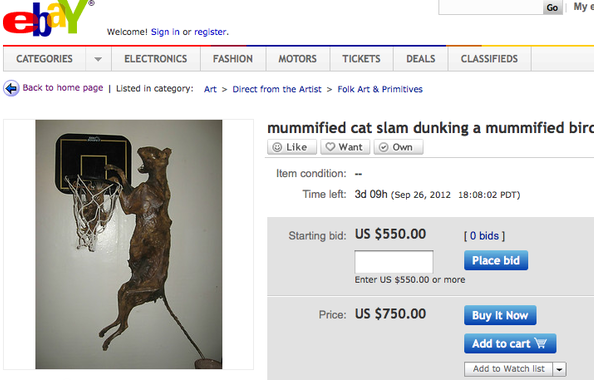 Mummified Cat Slam Dunking Mummified Bird